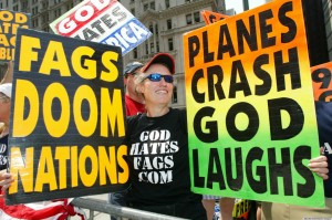 NEW YORK - JULY 4:  Shirley Phelps-Roper holds up signs as she joins fellow members of the Westboro Baptist Church, from Topeka, Kansas, as they protest across the street from Ground Zero July 4, 2004 in New York City. The church members believe that because of homosexuals and America's rebelious and immoral conducts, God has brought on acts of terrorism as a way of punishing society.  (Photo by Monika Graff/Getty Images)